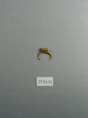 <em>Amulet in the Form of a Crescent</em>, 2nd-1st century B.C.E. Gold, 9/16 x 3/16 x 11/16 in. (1.5 x 0.5 x 1.7 cm, 1.35 g). Brooklyn Museum, Charles Edwin Wilbour Fund, 37.823E. Creative Commons-BY (Photo: Brooklyn Museum, CUR.37.823E_view1.jpg)