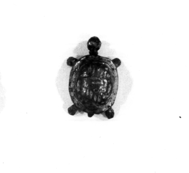 <em>Small Figure of a Tortoise</em>, 664-332 B.C.E. Bronze, gold, 3/8 x 9/16 x 1/2 in. (1 x 1.5 x 1.3 cm). Brooklyn Museum, Charles Edwin Wilbour Fund, 37.853E. Creative Commons-BY (Photo: , CUR.37.853E_NegID_37.853EGRPA_print_cropped_bw.jpg)