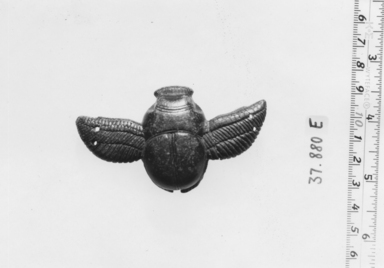 <em>Amulet? Representing a Winged Scarabeus</em>. Stone, 11/16 x 1 5/16 x 1 13/16 in. (1.8 x 3.4 x 4.6 cm). Brooklyn Museum, Charles Edwin Wilbour Fund, 37.880E. Creative Commons-BY (Photo: , CUR.37.880E_NegA_print_bw.jpg)