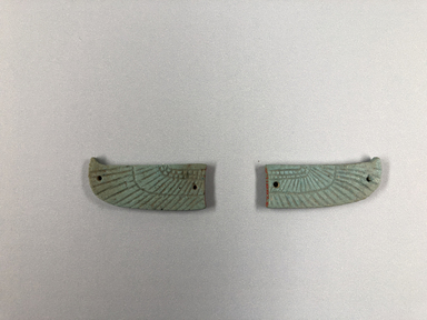 <em>Pair of Wings from a Winged Scarab</em>, 381-343 B.C.E. Faience, 37.881Ea: 3/4 × 3/16 × 1 15/16 in. (1.9 × 0.5 × 4.9 cm). Brooklyn Museum, Charles Edwin Wilbour Fund, 37.881Ea-b. Creative Commons-BY (Photo: , CUR.37.881Ea-b_view01.jpg)