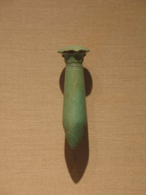 <em>Wadj-Scepter</em>, ca. 664-305 B.C.E. Faience, 4 3/4 x 1 1/2 in. (12 x 3.8 cm). Brooklyn Museum, Charles Edwin Wilbour Fund, 37.886E. Creative Commons-BY (Photo: Brooklyn Museum, CUR.37.886E_wwg8.jpg)
