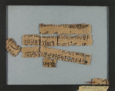 <em>Papyrus Inscribed in Hieratic</em>, ca. 1292-1190 B.C.E. Papyrus, ink, Glass: 7 5/8 x 9 9/16 in. (19.3 x 24.3 cm). Brooklyn Museum, Charles Edwin Wilbour Fund, 37.903E (Photo: Brooklyn Museum, CUR.37.903E_verso_IMLS_PS5.jpg)