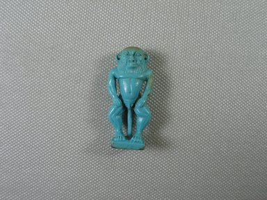 <em>Figure of Bes</em>, 664-343 B.C.E. Faience, 1 3/4 x 13/16 x 3/8 in. (4.4 x 2 x 1 cm). Brooklyn Museum, Charles Edwin Wilbour Fund, 37.911E. Creative Commons-BY (Photo: Brooklyn Museum, CUR.37.911E_view01.jpg)