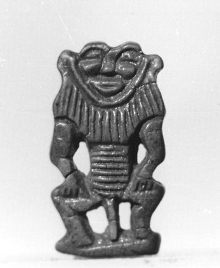 <em>Male Birth-God</em>, ca. 1539-1425 B.C.E. Faience, 1 1/4 x 11/16 x 3/16 in. (3.1 x 1.7 x 0.5 cm). Brooklyn Museum, Charles Edwin Wilbour Fund, 37.912E. Creative Commons-BY (Photo: Brooklyn Museum, CUR.37.912E_negL_897_9A_bw.jpg)