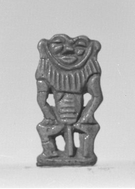 <em>Bes-Image Amulet</em>, 1539-1075 B.C.E. Faience, 1 1/8 × 9/16 × 3/16 in. (2.9 × 1.5 × 0.5 cm). Brooklyn Museum, Charles Edwin Wilbour Fund, 37.913E. Creative Commons-BY (Photo: Brooklyn Museum, CUR.37.913E_negL_897_10A_bw.jpg)
