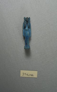 <em>Bast Amulet</em>, 664-343 B.C.E. Faience, 1 5/8 x 7/16 x 1/2 in. (4.1 x 1.1 x 1.3 cm). Brooklyn Museum, Charles Edwin Wilbour Fund, 37.928E. Creative Commons-BY (Photo: Brooklyn Museum, CUR.37.928E_View1.jpg)