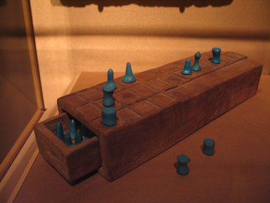 <em>Game Board with Separate Drawer</em>, ca. 1539-1295 B.C.E. Wood, 2 1/16 x 3 3/8 x 11 in. (5.3 x 8.5 x 28 cm). Brooklyn Museum, Charles Edwin Wilbour Fund, 37.93E. Creative Commons-BY (Photo: , CUR.37.93E_37.94E_mummychamber.jpg)