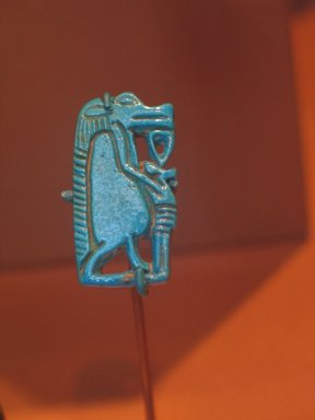 <em>Amulet of a Birth God</em>, ca. 1539-1478 B.C.E. Faience, 1 1/4 x 5/8 x 1/8 in. (3.2 x 1.6 x 0.3 cm). Brooklyn Museum, Charles Edwin Wilbour Fund, 37.967E. Creative Commons-BY (Photo: Brooklyn Museum, CUR.37.967E_erg2.jpg)