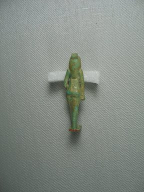 <em>Small Statue of Bast Walking</em>. Faience, glazed, 2 1/2 x 11/16 in. (6.4 x 1.8 cm). Brooklyn Museum, Charles Edwin Wilbour Fund, 37.976E. Creative Commons-BY (Photo: Brooklyn Museum, CUR.37.976E_View4.jpg)