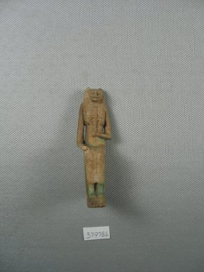 <em>Enthroned Bastet Figure</em>, 664-525 B.C.E. Faience, 2 15/16 x 7/8 x 1 7/16 in. (7.4 x 2.3 x 3.6 cm). Brooklyn Museum, Charles Edwin Wilbour Fund, 37.978E. Creative Commons-BY (Photo: Brooklyn Museum, CUR.37.978E_View1.jpg)