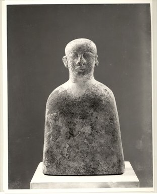 Nubian. <em>Funerary Bust of Male</em>, ca. 1352-1336 B.C.E. Sandstone, gesso, pigment, 10 7/8 x 6 7/16 x 2 7/8 in. (27.7 x 16.3 x 7.3 cm). Brooklyn Museum, Gift of the Egypt Exploration Society, 38.545. Creative Commons-BY (Photo: Brooklyn Museum, CUR.38.545_negA_bw.jpg)