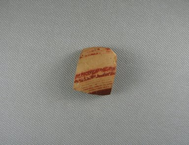 Mycenaean. <em>Jar Fragment</em>, ca. 1425-1300 B.C.E. Clay, pigment, 1 x 3/16 x 1 5/16 in. (2.6 x 0.4 x 3.3 cm). Brooklyn Museum, Gift of the Egypt Exploration Society, 38.556b. Creative Commons-BY (Photo: Brooklyn Museum, CUR.38.556b_view1.jpg)