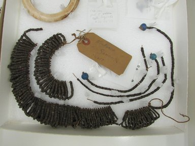 Samoan. <em>Necklace</em>. Coconut shell, fiber, clay, 14 15/16 x 4 3/4 in. (38 x 12 cm). Brooklyn Museum, Dick S. Ramsay Fund, 38.637. Creative Commons-BY (Photo: Brooklyn Museum, CUR.38.637.jpg)