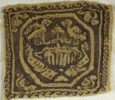 Coptic. <em>Square Fragment with Animal and Botanical Decoration</em>, 6th-7th century C.E. Wool, 2 1/2 x 2 3/4 in. (6.4 x 7 cm). Brooklyn Museum, Charles Edwin Wilbour Fund, 38.651. Creative Commons-BY (Photo: Brooklyn Museum (in collaboration with Index of Christian Art, Princeton University), CUR.38.651_ICA.jpg)