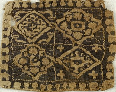 Coptic. <em>Square Fragment with Floral and Geometric Decoration</em>, 6th century C.E. Flax, wool, 4 1/2 x 3 5/8 in. (11.4 x 9.2 cm). Brooklyn Museum, Charles Edwin Wilbour Fund, 38.658. Creative Commons-BY (Photo: Brooklyn Museum (in collaboration with Index of Christian Art, Princeton University), CUR.38.658_ICA.jpg)