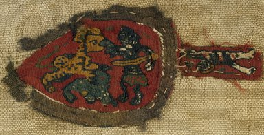 Coptic. <em>Fragment with Figural and Animal Decoration</em>, 7th century C.E. Wool, flax, 8 1/2 x 5 in. (21.6 x 12.7 cm). Brooklyn Museum, Charles Edwin Wilbour Fund, 38.670. Creative Commons-BY (Photo: Brooklyn Museum (in collaboration with Index of Christian Art, Princeton University), CUR.38.670_ICA.jpg)