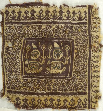 Coptic. <em>Square Fragment with Figural and Botanical Decoration</em>, 7th century C.E. Wool, 5 1/2 x 5 in. (14 x 12.7 cm). Brooklyn Museum, Charles Edwin Wilbour Fund, 38.672. Creative Commons-BY (Photo: Brooklyn Museum (in collaboration with Index of Christian Art, Princeton University), CUR.38.672_ICA.jpg)