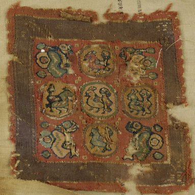 Coptic. <em>Square Fragment with Figural and Animal Decoration</em>, 6th-7th century C.E. Flax, wool, 7 1/4 x 7 in. (18.4 x 17.8 cm). Brooklyn Museum, Charles Edwin Wilbour Fund, 38.677. Creative Commons-BY (Photo: Brooklyn Museum (in collaboration with Index of Christian Art, Princeton University), CUR.38.677_ICA.jpg)