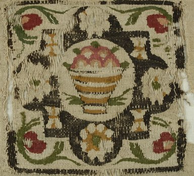 Coptic. <em>Basket of Fruit</em>, 5th-6th century C.E. Flax, wool, 11 1/2 x 12 in. (29.2 x 30.5 cm). Brooklyn Museum, Charles Edwin Wilbour Fund, 38.681. Creative Commons-BY (Photo: Brooklyn Museum (in collaboration with Index of Christian Art, Princeton University), CUR.38.681_ICA.jpg)