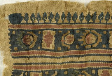 Coptic. <em>Fragment with Botanical Decoration</em>, 6th-7th century C.E. Wool (?), 4 1/8 x 6 1/4 in. (10.5 x 15.9 cm). Brooklyn Museum, Charles Edwin Wilbour Fund, 38.688. Creative Commons-BY (Photo: Brooklyn Museum (in collaboration with Index of Christian Art, Princeton University), CUR.38.688_detail01_ICA.jpg)