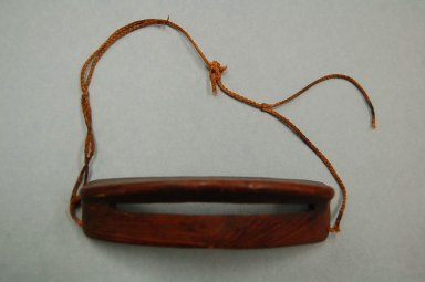 Eskimo. <em>Snow Goggles</em>, 19th or early 20th century. Wood, cord, 6 1/8 x 1 9/16in. (15.5 x 4cm). Brooklyn Museum, Gift of Frank K. Fairchild, 38.695. Creative Commons-BY (Photo: Brooklyn Museum, CUR.38.695.jpg)