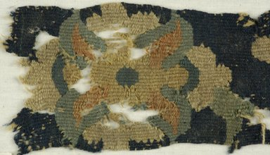 Coptic. <em>Fragment with Botanical Decoration</em>, 6th century C.E. Wool, 16 x 14 1/2 in. (40.6 x 36.8 cm). Brooklyn Museum, Charles Edwin Wilbour Fund, 38.747. Creative Commons-BY (Photo: Brooklyn Museum (in collaboration with Index of Christian Art, Princeton University), CUR.38.747_ICA.jpg)