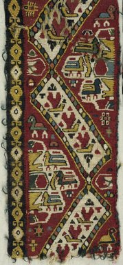 Coptic. <em>Band Fragment with Animal, Botanical, and Geometric Decoration</em>, 7th century C.E. Flax (?), wool, 14 3/4 x 4 1/4 in. (37.5 x 10.8 cm). Brooklyn Museum, Charles Edwin Wilbour Fund, 38.750. Creative Commons-BY (Photo: Brooklyn Museum (in collaboration with Index of Christian Art, Princeton University), CUR.38.750_detail01_ICA.jpg)