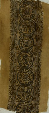 Coptic. <em>Band Fragment with Figural, Animal, and Botanical Decoration</em>, 6th-7th century C.E. Wool, 18 3/4 x 8 1/4 in. (47.6 x 21 cm). Brooklyn Museum, Charles Edwin Wilbour Fund, 38.755. Creative Commons-BY (Photo: Brooklyn Museum (in collaboration with Index of Christian Art, Princeton University), CUR.38.755_ICA.jpg)