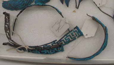 <em>Manchu Woman's Court Headdress</em>. Silver, feathers, diam.: 6 in. Brooklyn Museum, Gift of Mrs. Frederic B. Pratt, 38.97. Creative Commons-BY (Photo: Brooklyn Museum, CUR.38.97.jpg)