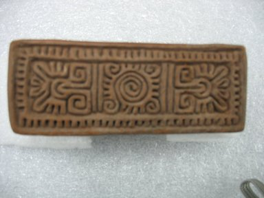 Possibly Aztec. <em>Stamp</em>, 1000-1500. Ceramic, 4 1/4 x 2 1/8 x 1 5/8 in. (10.8 x 5.4 x 4.1 cm). Brooklyn Museum, Ella C. Woodward Memorial Fund, 39.123.14. Creative Commons-BY (Photo: Brooklyn Museum, CUR.39.123.14.jpg)