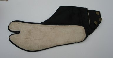 <em>Pair of Socks</em>. Sateen, One of the socks: 3 3/4 x 9 13/16 in. (9.5 x 25 cm). Brooklyn Museum, Museum Collection Fund, 40.151d. Creative Commons-BY (Photo: Brooklyn Museum, CUR.40.151d_bottom.jpg)