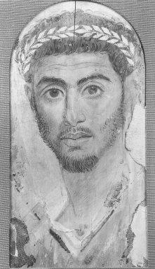 <em>Mummy Portrait of a Man</em>, ca. 120-130 C.E. Wood (Common cypress - Cupressus Sempervirens), encaustic, gold leaf, 17 1/4 x 7 3/4 x 1/16 in. (43.8 x 19.7 x 0.2 cm). Brooklyn Museum, Charles Edwin Wilbour Fund, 40.386 (Photo: Brooklyn Museum, CUR.40.386_NegA_print_bw.jpg)