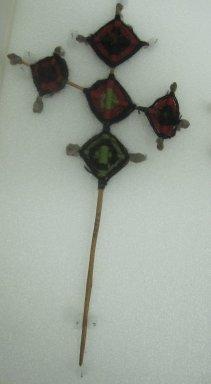 Huichol (Wixárika). <em>God's Eye</em>. Yarn, wood, cotton, 6 3/16 x 11 1/2 in. (15.7 x 29.2 cm). Brooklyn Museum, Ella C. Woodward Memorial Fund, 40.752. Creative Commons-BY (Photo: Brooklyn Museum, CUR.40.752.jpg)