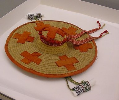 Huichol (Wixárika). <em>Shaman's Hat</em>. Straw with red cloth appliqued crosses Brooklyn Museum, Gift of Edwin Forgan Myers, 40.755. Creative Commons-BY (Photo: Brooklyn Museum, CUR.40.755.jpg)