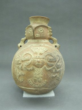 Chimú. <em>Jar with Spout in the Form of an Owl Face</em>, ca.1100-1400. Ceramic, 8 3/4 x 6 3/4 x 6 1/4 in. (22.2 x 17.1 x 15.9 cm). Brooklyn Museum, Museum Expedition 1941, Frank L. Babbott Fund, 41.1275.87. Creative Commons-BY (Photo: Brooklyn Museum, CUR.41.1275.87_view1.jpg)