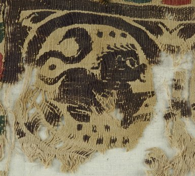 Coptic. <em>Band Fragment with Animal and Botanical Decoration</em>, 5th century C.E. Flax, wool, 9 1/4 x 18 1/4 in. (23.5 x 46.4 cm). Brooklyn Museum, Gift of Pratt Institute, 41.805. Creative Commons-BY (Photo: Brooklyn Museum (in collaboration with Index of Christian Art, Princeton University), CUR.41.805_detail01_ICA.jpg)