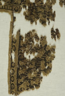 Coptic. <em>Fragment with Figural and Animal Decoration</em>, 7th-8th century C.E. Wool, 15 1/4 x 10 1/4 in. (38.7 x 26 cm). Brooklyn Museum, Gift of Pratt Institute, 41.809. Creative Commons-BY (Photo: Brooklyn Museum (in collaboration with Index of Christian Art, Princeton University), CUR.41.809_detail01_ICA.jpg)