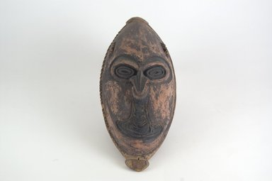 <em>Mask</em>. Painted wood, 2 1/16 x 4 3/16 x 9 13/16 in. (5.2 x 10.6 x 25 cm). Brooklyn Museum, By exchange, 42.114.9. Creative Commons-BY (Photo: Brooklyn Museum, CUR.42.114.9_front_PS5.jpg)