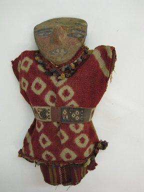 <em>Doll</em>. Ceramic, cotton?, camelid fiber?, pigment, 9 1/16 x 4 5/16 x 1 9/16 in. (23 x 11 x 4 cm). Brooklyn Museum, A. Augutus Healy Fund, 42.150. Creative Commons-BY (Photo: Brooklyn Museum, CUR.42.150_view1.jpg)