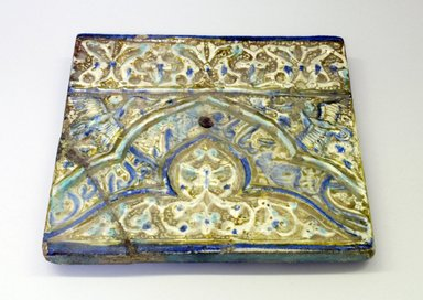 <em>Mihrab Tile</em>, 13th-14th century. Pottery, 9 7/16 x 11/16 x 10 3/16 in. (24 x 1.8 x 25.8 cm). Brooklyn Museum, Gift of Mrs. Horace O. Havemeyer, 42.212.21. Creative Commons-BY (Photo: Brooklyn Museum, CUR.42.212.21.jpg)