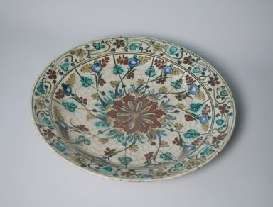 <em>Large Plate</em>, early 17th century. Ceramic, Kubachi ware; fritware, painted in olive green, cobalt blue and turquoise green with red and yellow slips under a transparent glaze, 2 5/16 x 13 5/8 in. (5.8 x 34.6 cm). Brooklyn Museum, Gift of Mrs. Horace O. Havemeyer, 42.212.24. Creative Commons-BY (Photo: Brooklyn Museum, CUR.42.212.24.jpg)