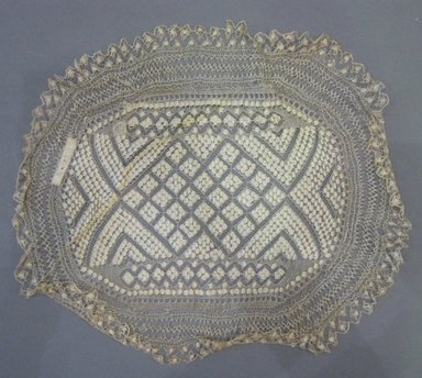 <em>Oval Linen Lace Doily</em>. Linen, 13 1/2 x 11 3/4 in. (34.3 x 29.8 cm). Brooklyn Museum, 42.221.56 (Photo: Brooklyn Museum, CUR.42.221.56.jpg)