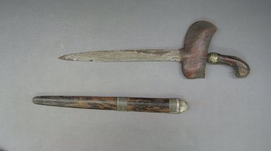 <em>Kris and Scabbard</em>. Iron, wood, tin Brooklyn Museum, Gift of D. Irving Mead, 42.302.4a-b. Creative Commons-BY (Photo: Brooklyn Museum, CUR.42.302.4a-b.jpg)