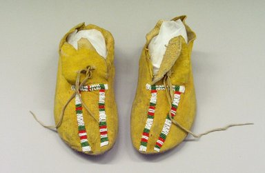 Comanche. <em>Pair of Woman's Moccasins</em>, early 20th century. Deerskin, glass bead, pigment, 9 13/16 x 3 15/16 in.  (25.0 x 10.0 cm). Brooklyn Museum, Gift of Mrs. Percy Jackson, 43.156.11. Creative Commons-BY (Photo: Brooklyn Museum, CUR.43.156.11.jpg)