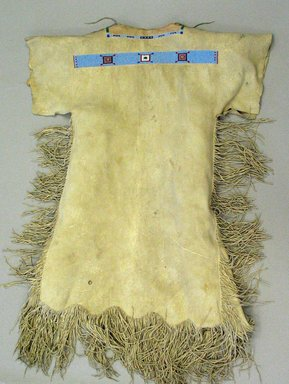 Cheyenne. <em>Woman's Dress</em>, 20th century. Elk skin, beads, 50 1/4 x 37 in. (127.6 x 94 cm). Brooklyn Museum, Gift of Mrs. Percy Jackson, 43.156.1. Creative Commons-BY (Photo: Brooklyn Museum, CUR.43.156.1_view1.jpg)