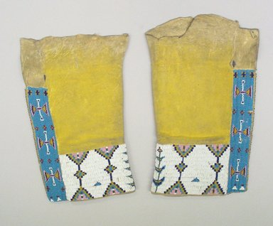 Cheyenne. <em>Woman's Leggings</em>, 1900-1940. Elkskin, beads, pigment, A: 16 5/16 x 9 3/4 x 1 3/8 in. (41.4 x 24.8 x 3.5 cm). Brooklyn Museum, Gift of Mrs. Percy Jackson, 43.156.2a-b. Creative Commons-BY (Photo: Brooklyn Museum, CUR.43.156.2a-b_view1.jpg)