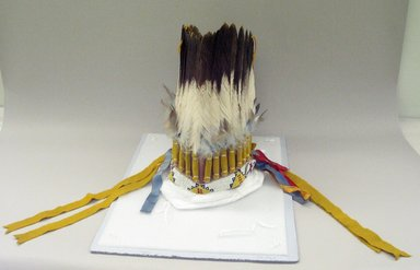 Probably Sioux. <em>Headdress or Feather Bonnet</em>, 20th century. Hide, feathers, beads, ribbon, flannel, pigment, approximate: 19 x 9 x 7 in. (48.3 x 22.9 x 17.8 cm). Brooklyn Museum, Gift of Mrs. Percy Jackson, 43.156.6. Creative Commons-BY (Photo: Brooklyn Museum, CUR.43.156.6_view1.jpg)