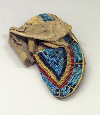 Ute. <em>Moccasin</em>, 1901-1933. Buckskin, beads, 5 1/2 x 2 3/8 in. (14 x 6 cm). Brooklyn Museum, Gift of Mrs. Percy Jackson, 43.156.7. Creative Commons-BY (Photo: Brooklyn Museum, CUR.43.156.7_view1.jpg)