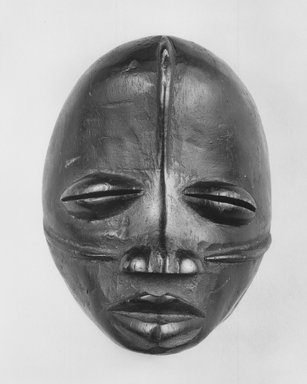 Possibly Wobe. <em>Mask</em>, 19th century. Wood, pigment, 5 7/8 x 4 1/2 in. (15 x 11.5 cm). Brooklyn Museum, Gift of Arthur Wiesenberger, 43.177.9. Creative Commons-BY (Photo: Brooklyn Museum, CUR.43.177.9_print_bw.jpg)