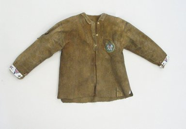 Plains. <em>Tailored Jacket</em>, 1930-1940s. Hide, beads, 29 1/8 x 20 7/8 in. (74 x 53 cm). Brooklyn Museum, Anonymous gift in memory of Dr. Harlow Brooks, 43.201.107. Creative Commons-BY (Photo: Brooklyn Museum, CUR.43.201.107_view1.jpg)